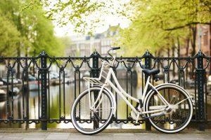 41208835 - bicycle on the city street river channel bridge in amsterdam